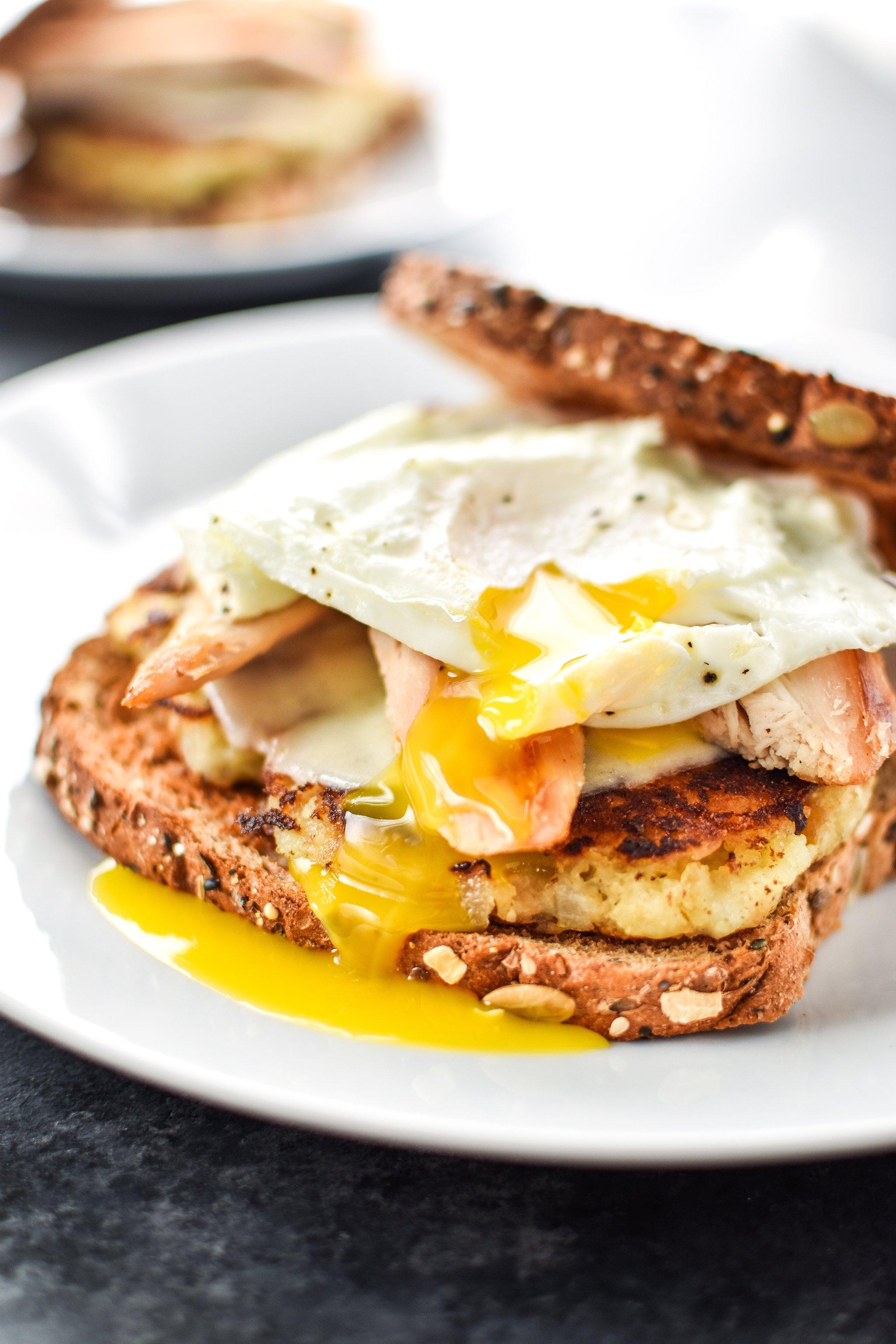 Ultimate Leftover Turkey Breakfast Sandwich on a white plate