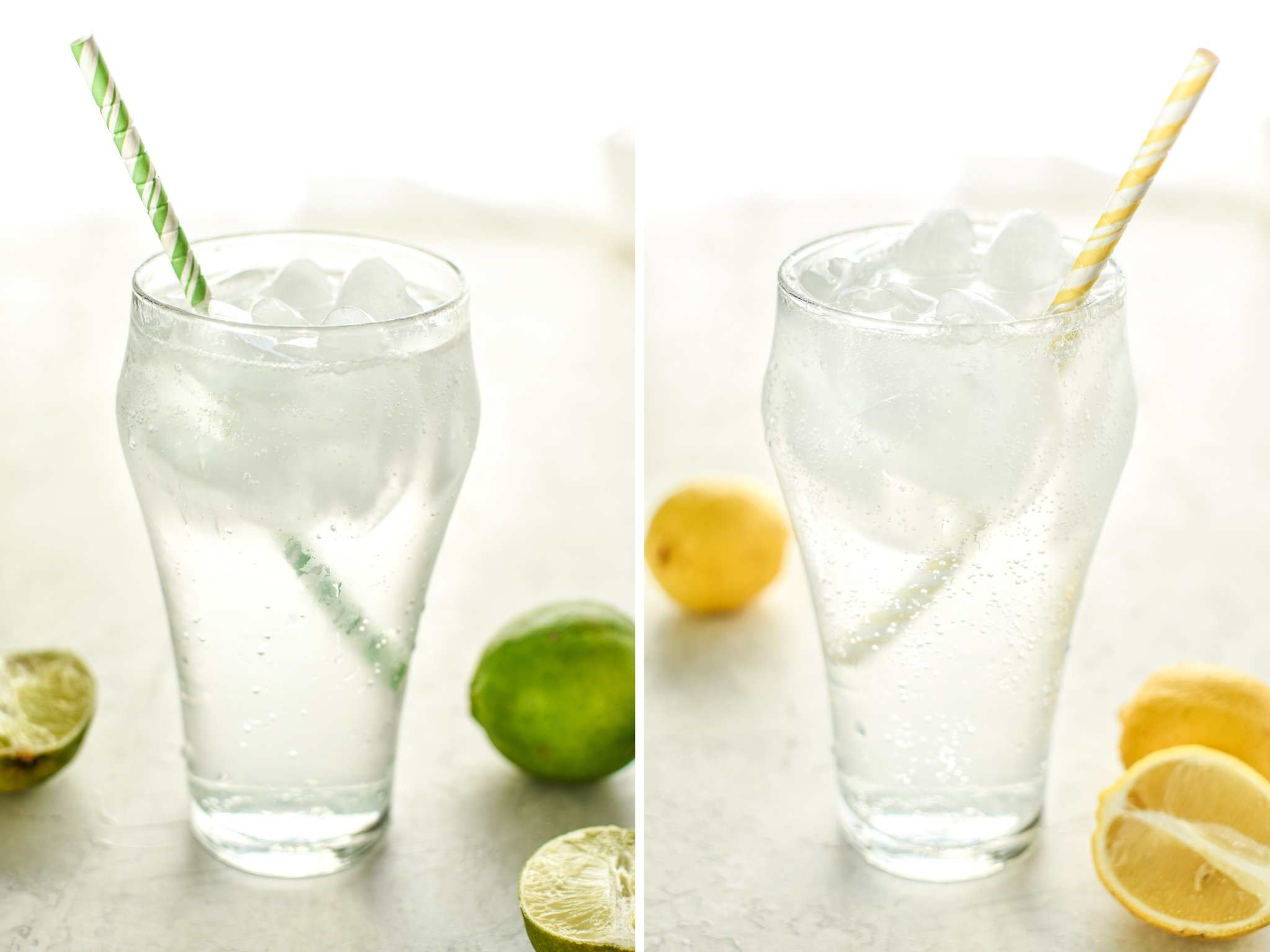 Two different variations of homemade la croix in big glasses with ice and straws, including lemon and lime.