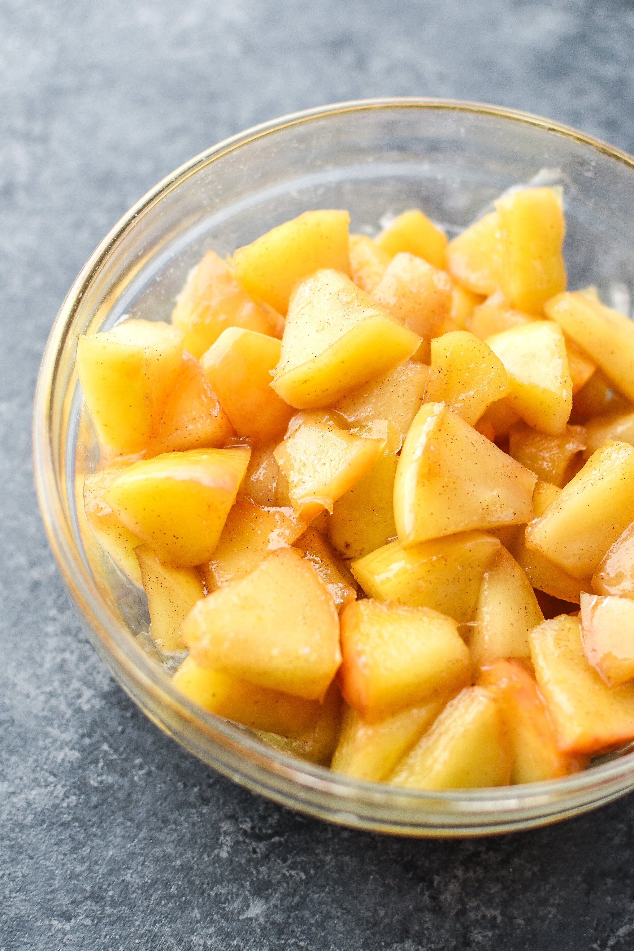 Sauteed apples with honey and cinnamon in a bowl.
