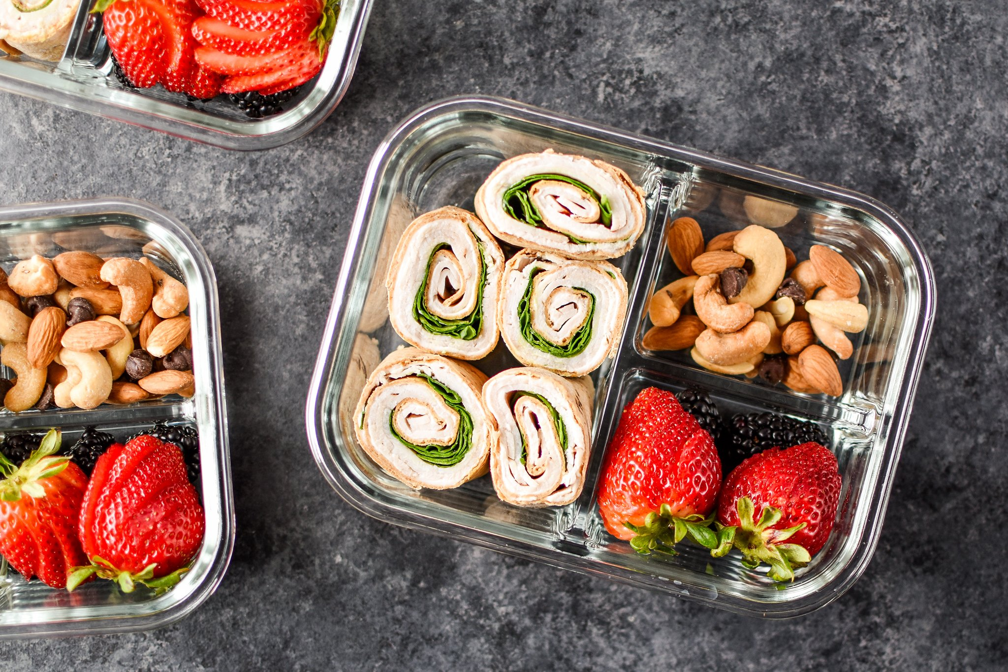 A view of the Easy Turkey Pinwheel Meal Prep from above with berries and nuts.