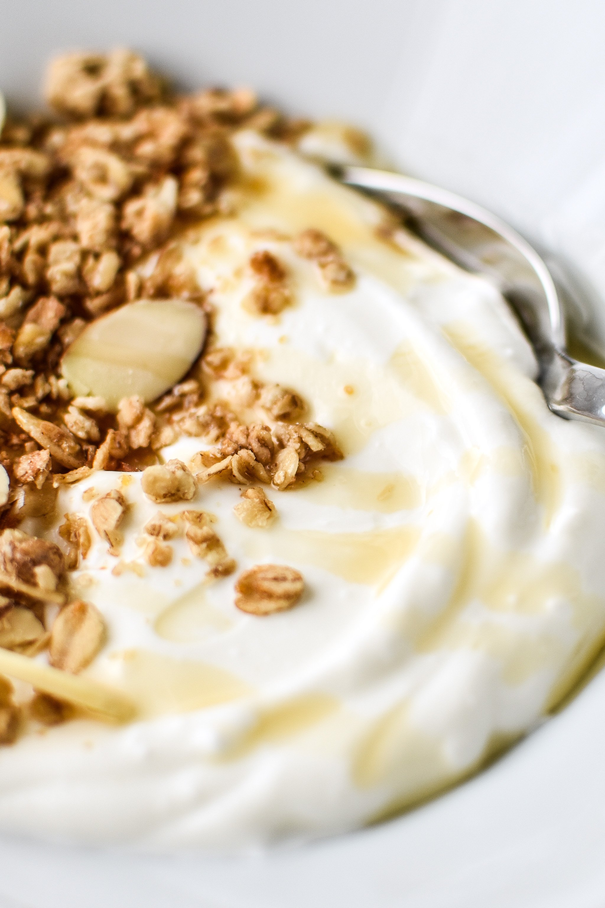 Freshly made yogurt with granola and a light maple syrup drizzle.