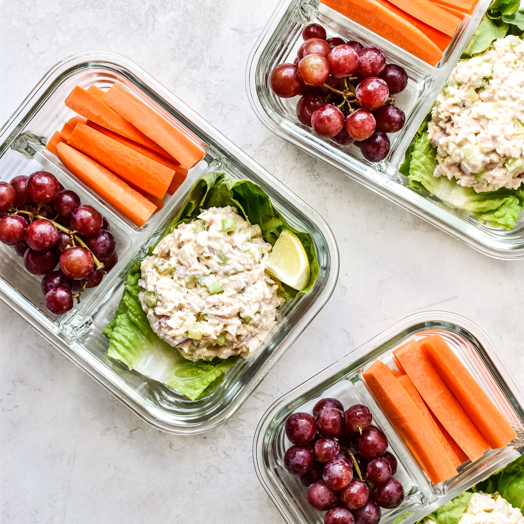 Tuna salad meal prep with grapes and carrots in meal prep containers.