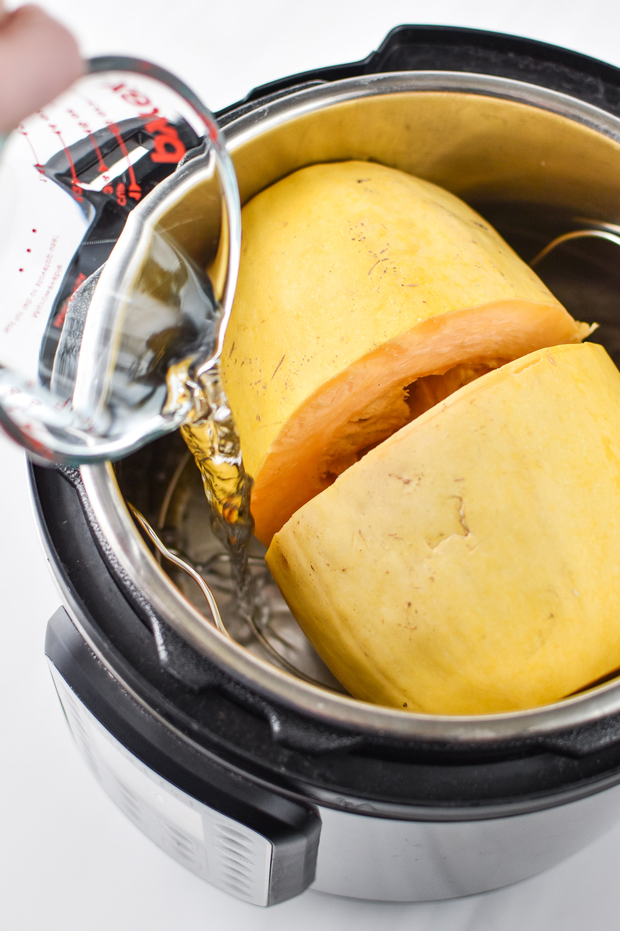 Cooking a spaghetti squash in the Instant Pot for the Whole30 Chicken Bacon Ranch Casserole.