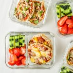 English muffin mini pizzas meal prep with fresh cut cucumbers and strawberries