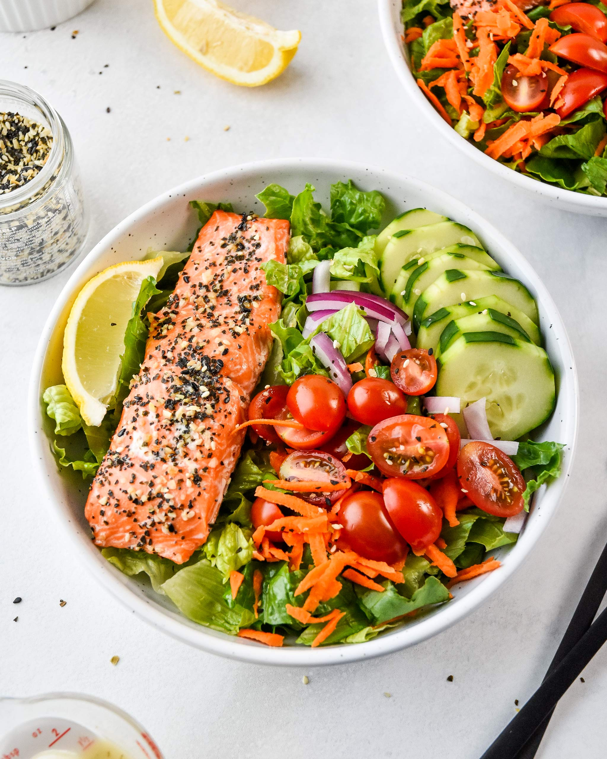 Everything Bagel Salmon Salad Bowls feature baked salmon with everything but the bagel seasoning and lots of veggies