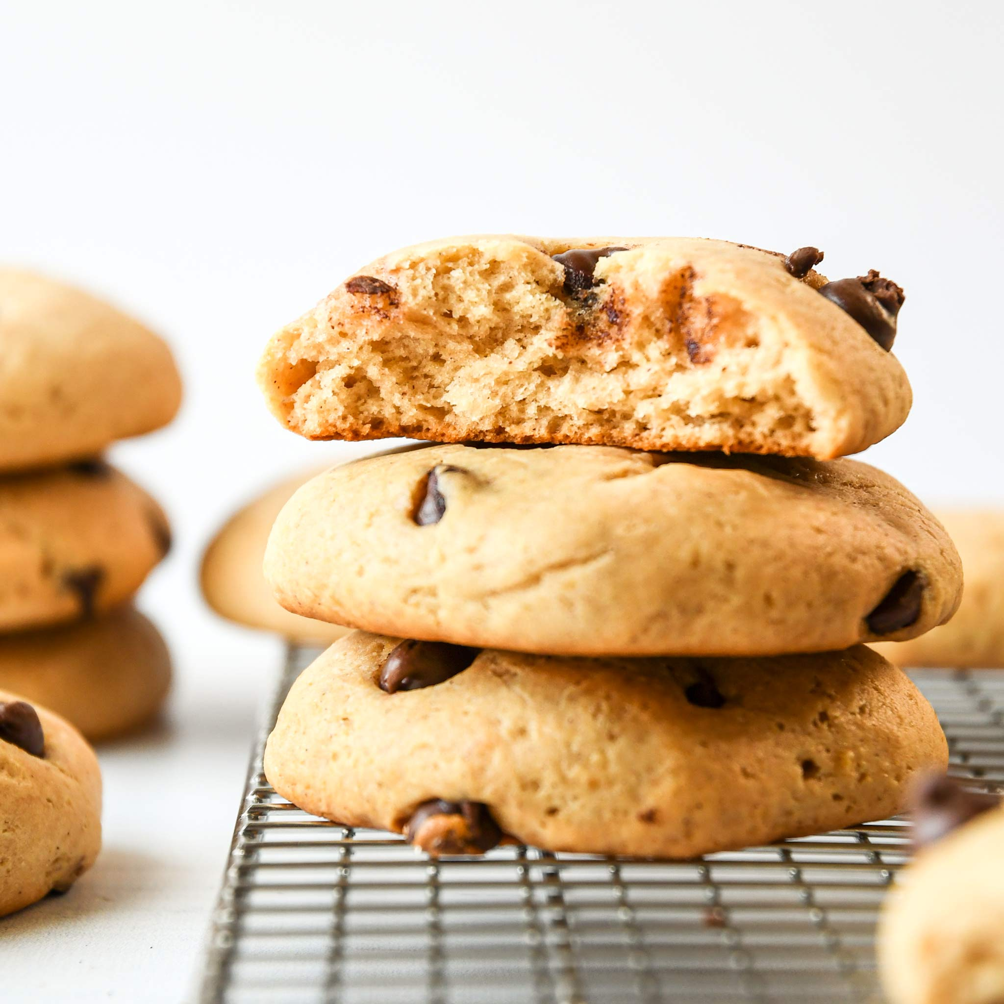Chocolate chip pancake mix cookies on a cooling rack after being baked