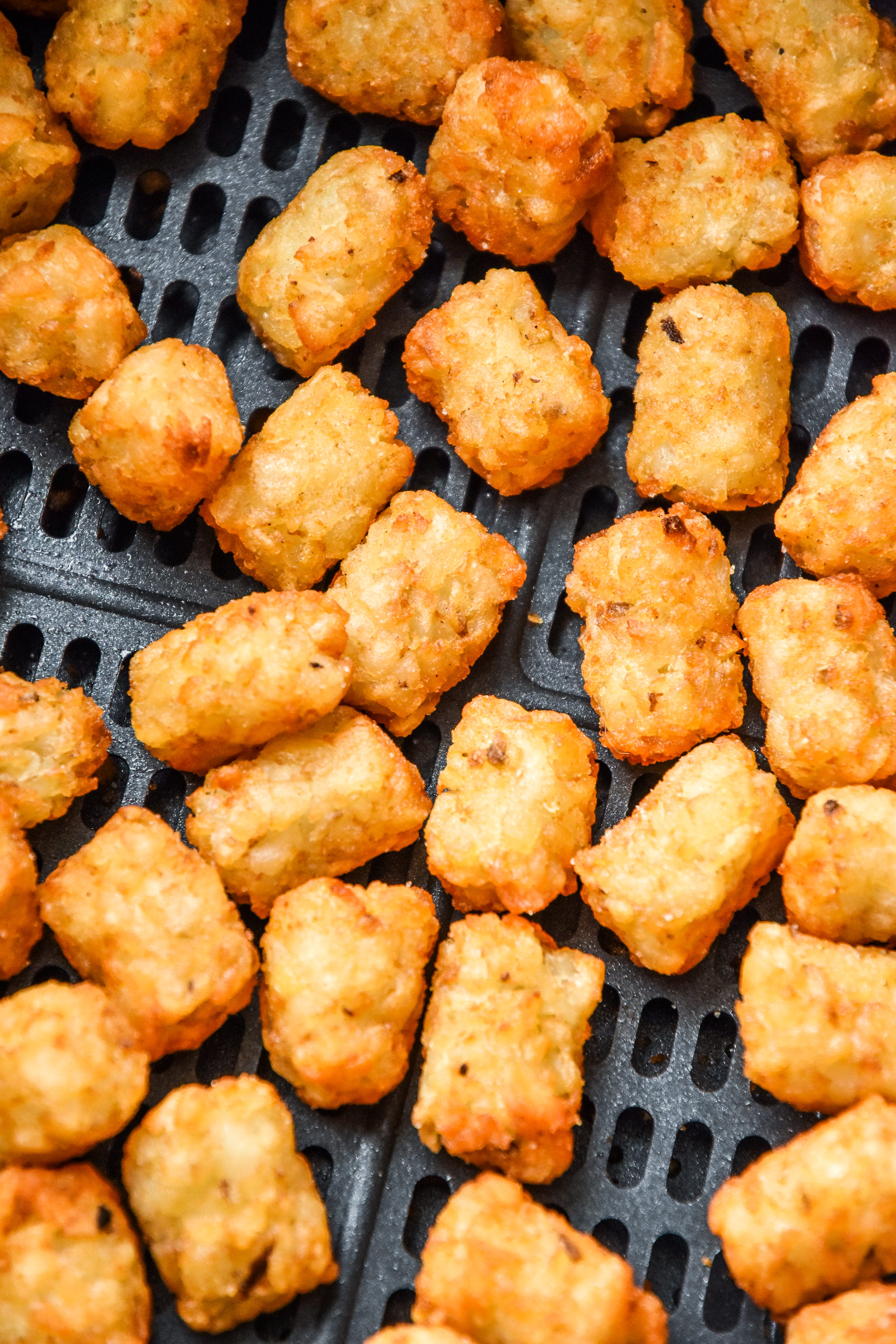 close up of tater tots cooked in an air fryer