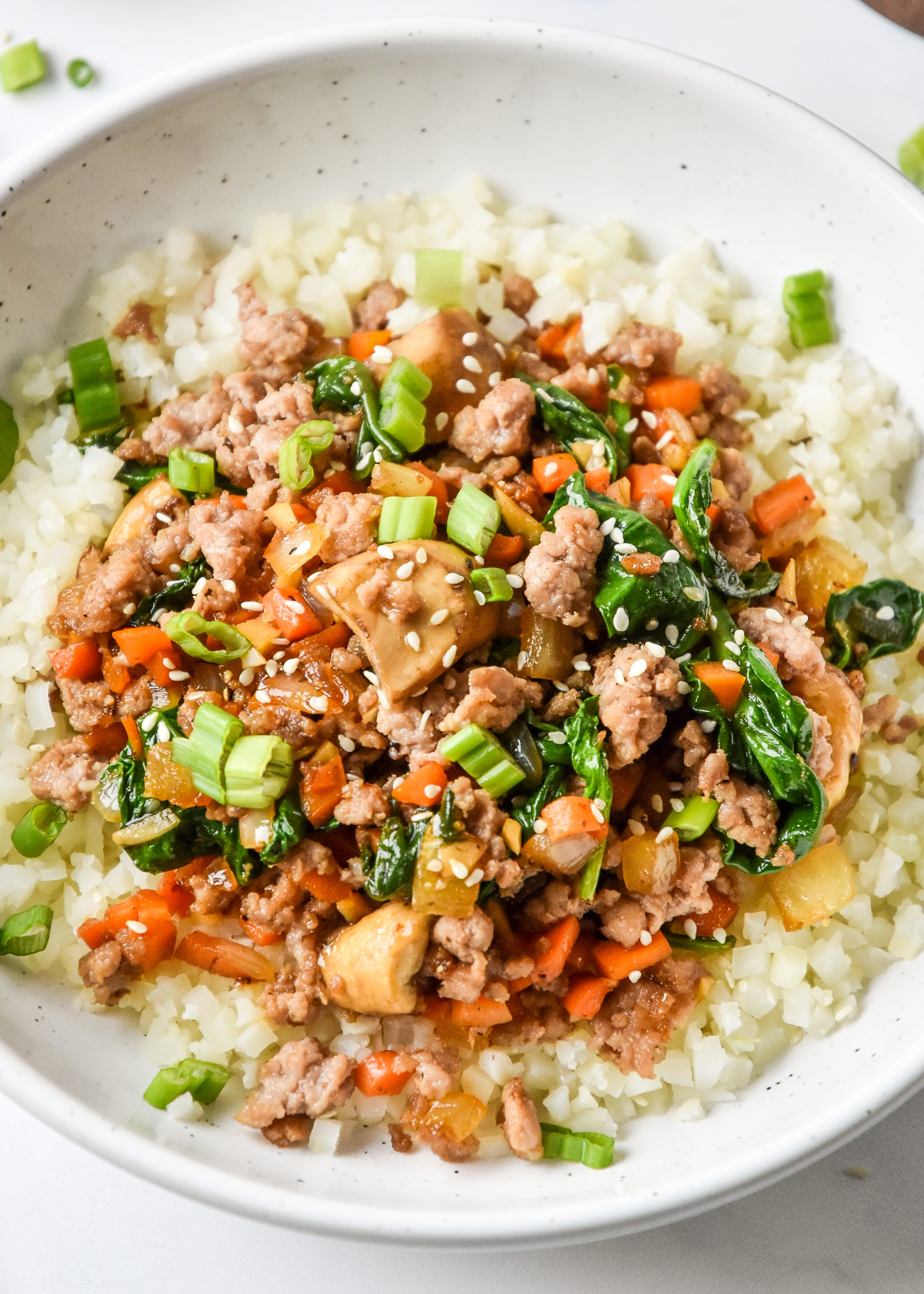 one serving vegetable pork bowl close up with cauliflower rice