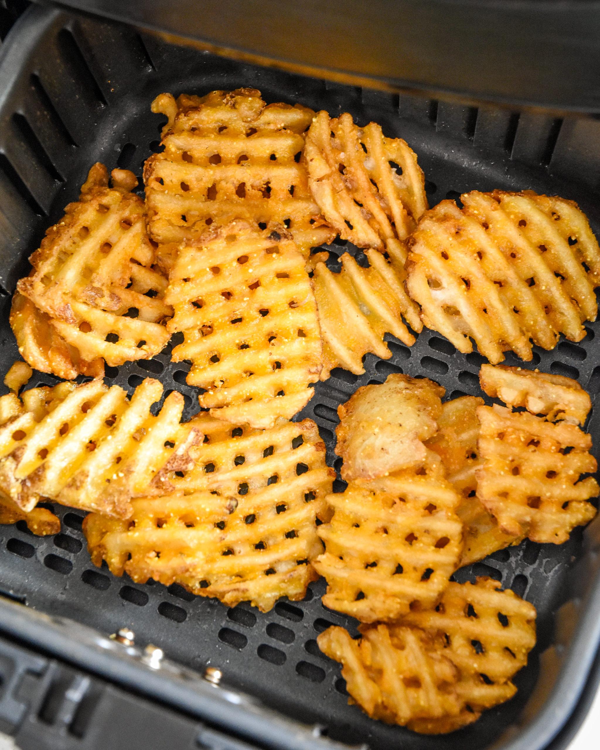 waffle fries in an air fryer basket