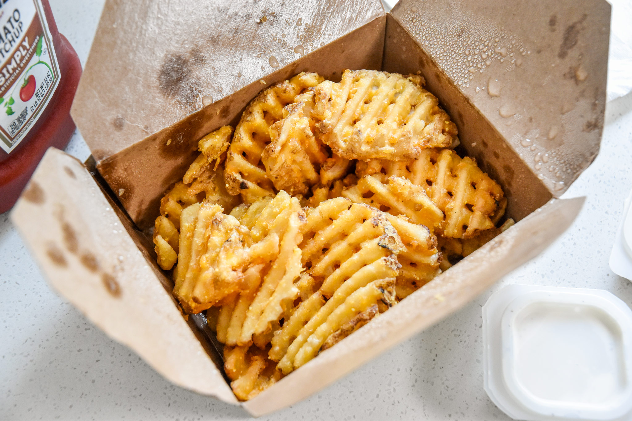 leftover fries in a take out container