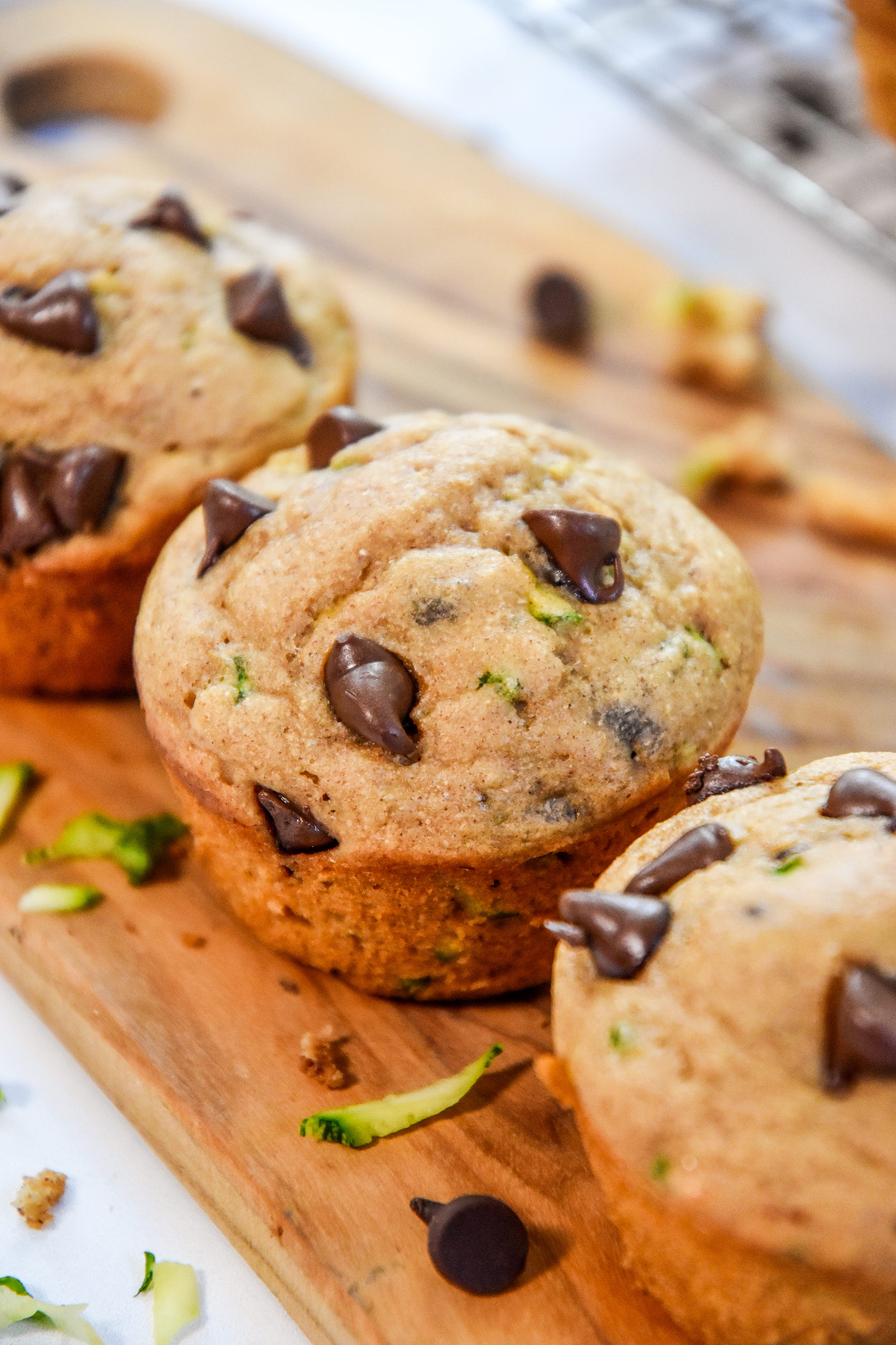 golden brown baked pancake mix zucchini muffins on a cutting board.