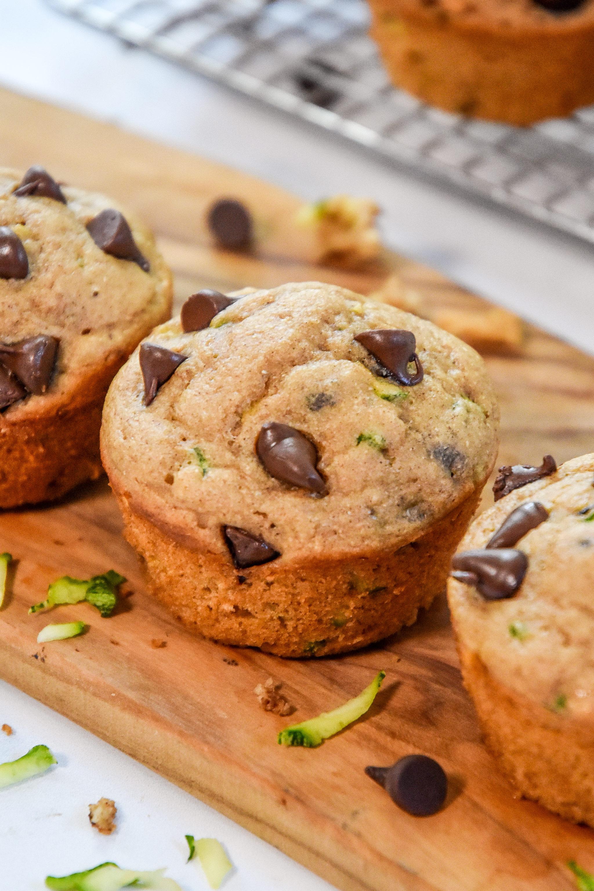 pancake mix zucchini muffins with chocolate chips on a cutting board.