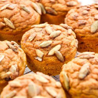pumpkin spice pancake mix muffins on a cooling rack.
