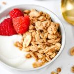 easy peanut butter granola with raspberries and yogurt.
